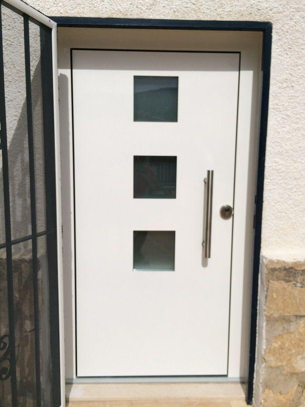 Puerta de entrada a vivienda de aluminio en calpe for Puerta entrada aluminio