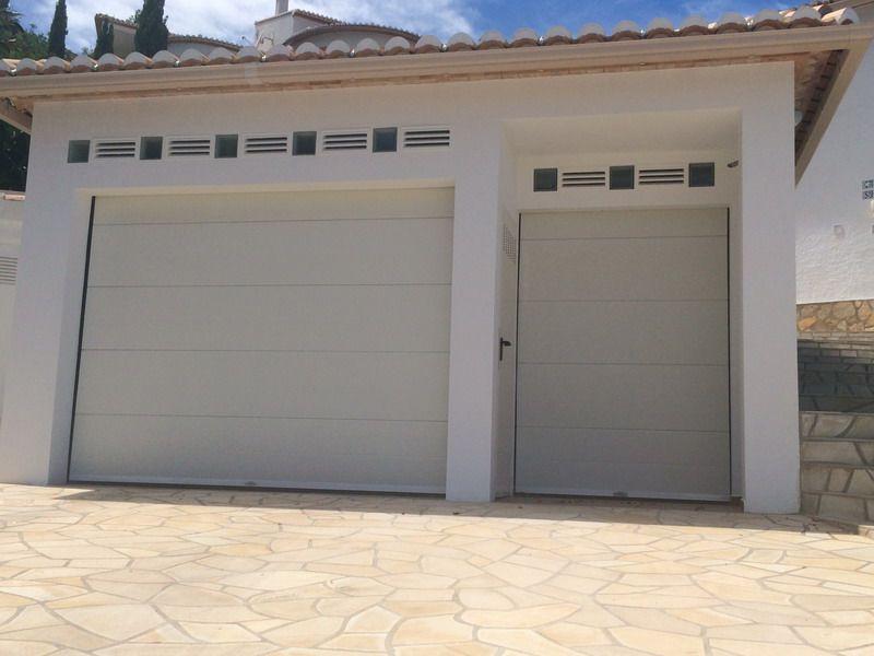 Montaje de puertas seccionales residenciales comunitarias e industriales - Montaje de puertas ...
