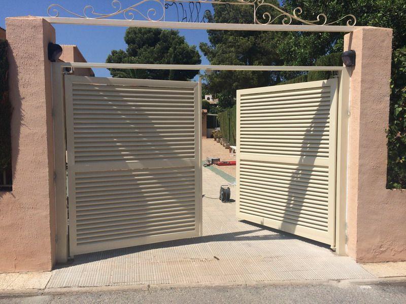 Puerta automatica batiente de dos hojas en mallorquina for Motor puerta automatica