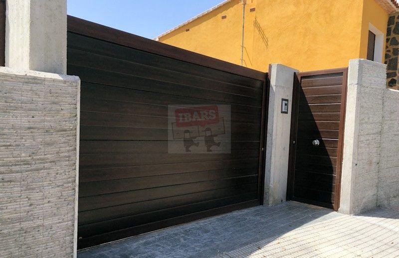 Home automatismos ibars for Puertas imitacion madera exterior